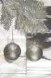 Christmas balls with package on silver background