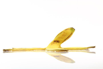 peel of banana with reflection isolated on white background