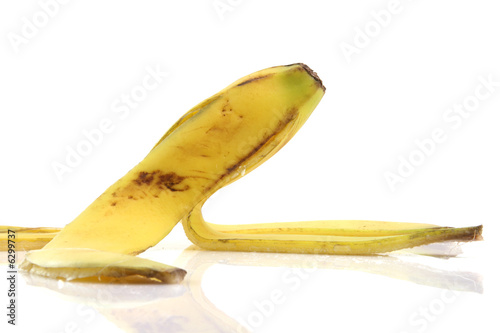 deatil from peel of banana with reflection isolated on white
