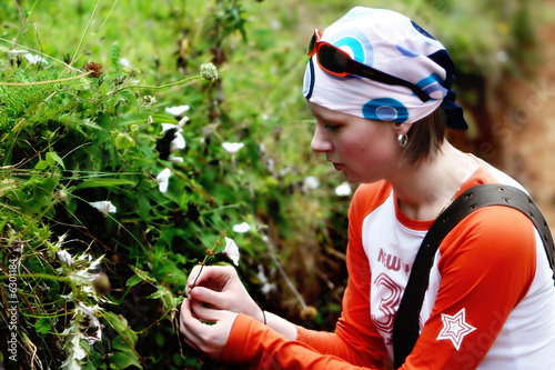 girl smelling flowers on mountain Kenya