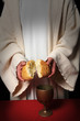 Jesus breaking bread as a symbol of Communion