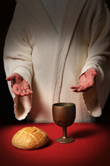 Jesus with scars in his hands at the Communion table