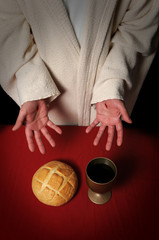 Jesus hands with scars ofering the Communion elements