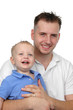 Father and son smiling against a white background