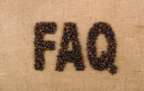 The word FAQ from coffee beans on linea material