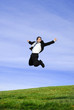 successful and happy young adult businessman jumping