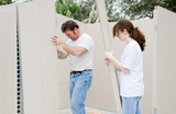 Teen girl helping her dad with a home improvement project.   poster