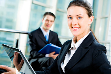 Confident business woman looking at camera