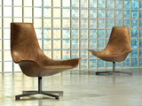 Design lounge chair in abstract studio interior