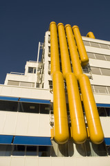 modern building with yellow airco pipes