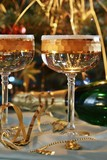 Two glass, bottle champagne and christmas festive atmosphere poster