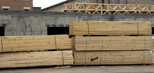Stacks of lumber at a commercial construction site