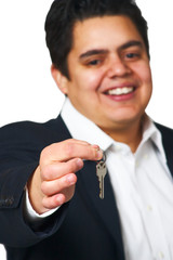 Happy man giving keys