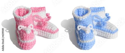 Newborn baby, girl or boy. symbols Tiny bootees - pink, blue