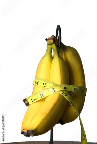 Measuring tape around a bunch of Bananas.