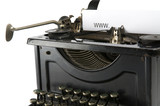 An old ancient typewriter is used to type an internet address.  poster