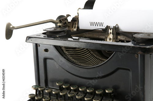 An old ancient typewriter is used to type an internet address.