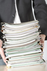 a businessman holding files
