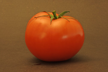 Red Tomato on brown background