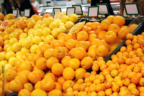 Fruits in a shop with blank board (shallow DOF)