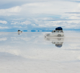 jeep in the salt lake salar de uyuni, bolivia.