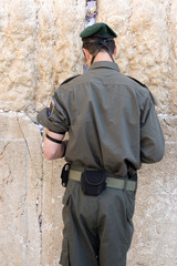 The Israeli soldier prays at the Wailing Wall. Jerusalem, Israel
