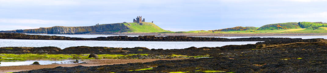 Panorama of Embleton Bay with view of Dunstanburgh Castle