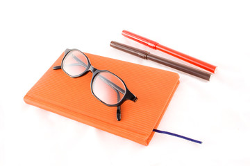 red book and black glasses
