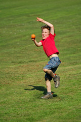 boy throwing a ball