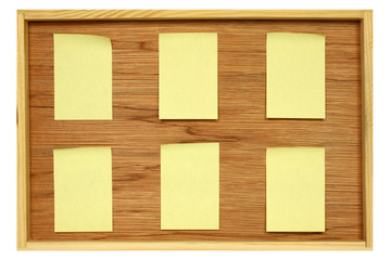 Notice board with six blank stickies
