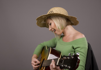 Blonde in Straw Hat Plaing Guitar
