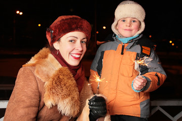 mother and son with sparklers