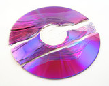 Scratched and broken purple DVD or CD. poster