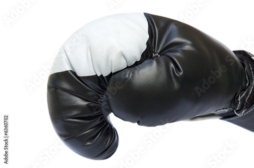 Red boxing glove ready to punch isolated over white