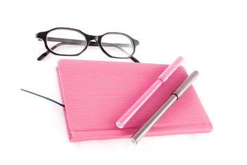 purple book, glasses and markers