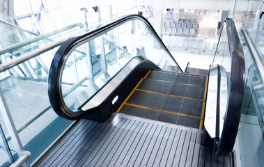 moving  escalator in the office hall perspective view