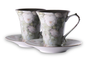 Tea cups over white background