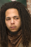 young man with dreadlocks and piercing poster