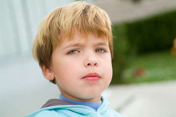 portrait of a boy with sad expression face