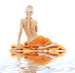 picture of beautiful lady with orange towels on white sand