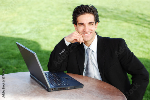 confident and successful young adult businessman