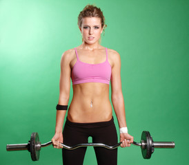 sexy girl is lifting weights against green screen