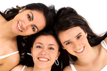 female friends smiling isolated over a white background