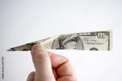 a paper plane made of a dollar note