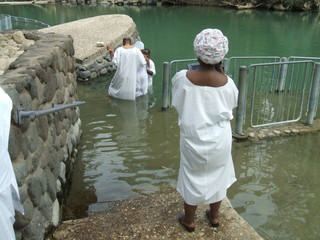 People baptizing in Jordan River in Israel
