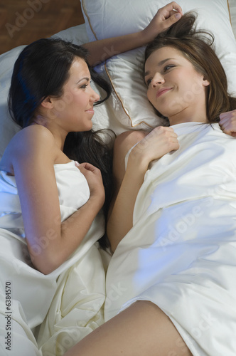 two sweet girls friend in the same bed talking