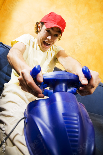 poster of playing video games: guy having fun with his brand new videogame