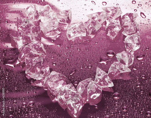 heart from ice on pink background