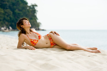 woman relaxing and sun bathe at the beach
