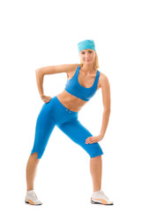 Beautiful young woman doing fitness exercise